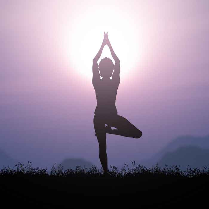 3D female in yoga pose against a sunset landscape
